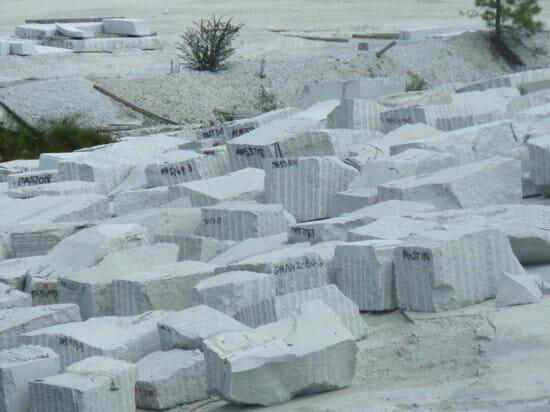 granite boulders images - block of granites in quarry