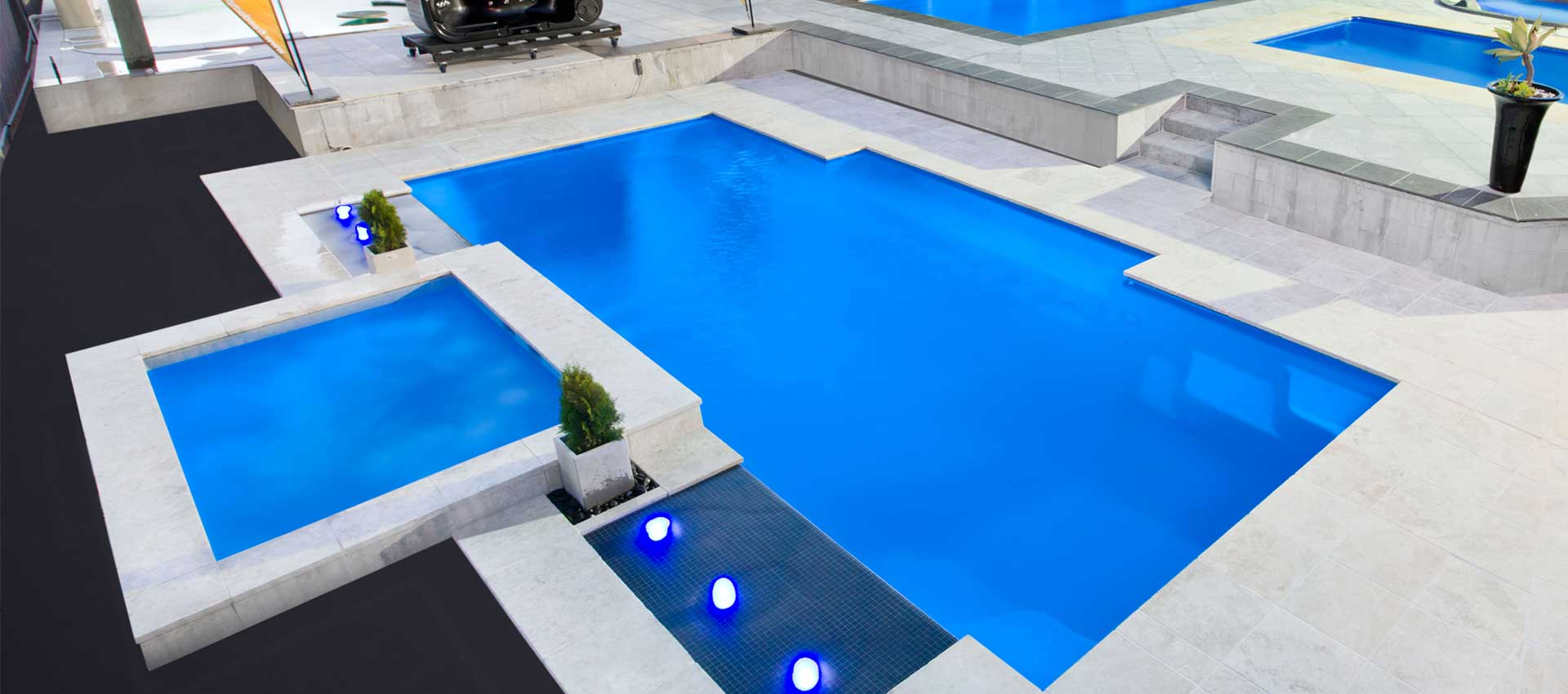 WHITE-GRANITE-PAVERS-around-a-swimming-pool-in-Melbourne