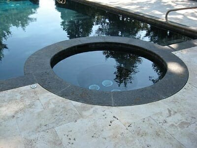 curved-granite-pool-coping-tiles-on-a-spa-5